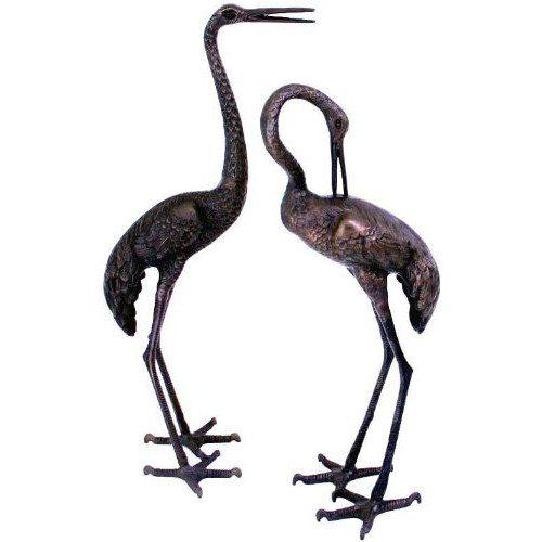 Pair of aluminium bronzed Cranes
