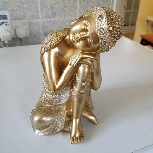 Soft Gold Buddha Resting On Knee